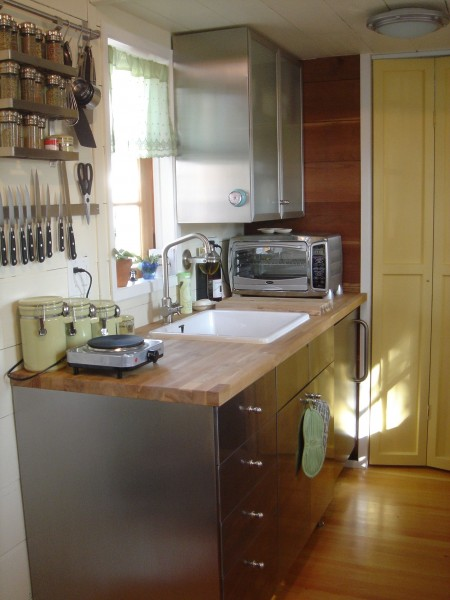Large sink, nice countertop and stainless steel cabinetry, including refrigerator