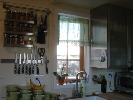 Kitchen with stainless steel Ikea cabinet.