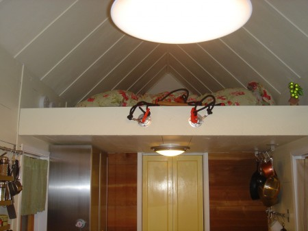 Sleeping loft with rope ladder above the kitchen