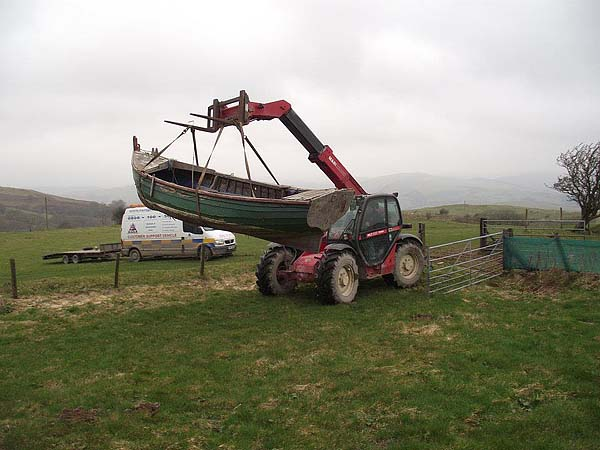 lifting the boat into place