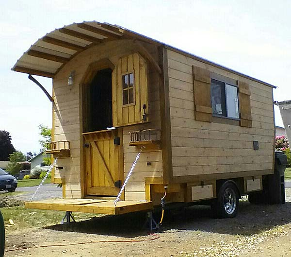 The Little Rustic Cabin on Wheels - Tiny House Blog on home hardware plans, michael daily home plans, 2012 most popular home plans, energy homes plans, home bathroom plans, house plans, home roof plans, home lighting plans, home design, home plans 1940, home building, home apartment plans, home architecture, home security plans, group home plans, country kitchen home plans, designing home plans, family home plans, garage plans, home furniture,